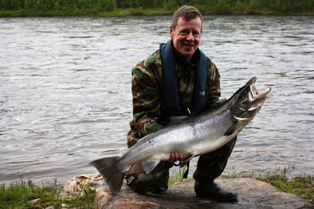 The happy customer with the Lapland wild salmon.